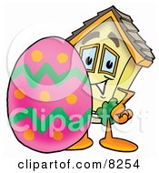 Clipart Picture Of A House Mascot Cartoon Character Standing Beside An Easter Egg