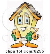 Clipart Picture Of A House Mascot Cartoon Character Pointing At The Viewer
