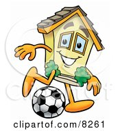 Clipart Picture Of A House Mascot Cartoon Character Kicking A Soccer Ball