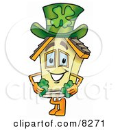 Clipart Picture Of A House Mascot Cartoon Character With A Green Four Leaf Clover On St Paddys Or St Patricks Day