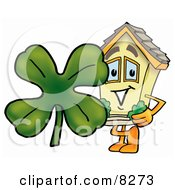 House Mascot Cartoon Character With a Green Four Leaf Clover on St Paddy's or St Patricks Day