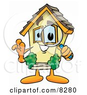 Clipart Picture Of A House Mascot Cartoon Character Looking Through A Magnifying Glass
