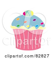 Royalty Free RF Clipart Illustration Of An Easter Cupcake With Sprinkles And An Egg On Top by Pams Clipart