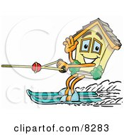 Clipart Picture Of A House Mascot Cartoon Character Waving While Water Skiing