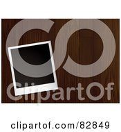 Royalty Free RF Clipart Illustration Of A Blank Instant Polaroid Photo Picture Over Dark Wood Panels by michaeltravers