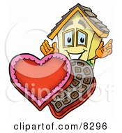 Clipart Picture Of A House Mascot Cartoon Character With An Open Box Of Valentines Day Chocolate Candies