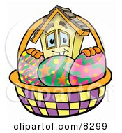 Clipart Picture Of A House Mascot Cartoon Character In An Easter Basket Full Of Decorated Easter Eggs