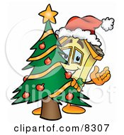 House Mascot Cartoon Character Waving And Standing By A Decorated Christmas Tree by Toons4Biz