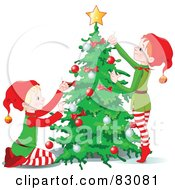 Two Christmas Elves Decorating A Christmas Tree Together