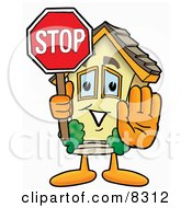 Clipart Picture Of A House Mascot Cartoon Character Holding A Stop Sign by Toons4Biz