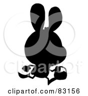 Royalty Free RF Clipart Illustration Of A Solid Black Silhouette Of An Egg Hunting Bunny