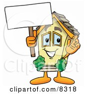 Clipart Picture Of A House Mascot Cartoon Character Holding A Blank Sign