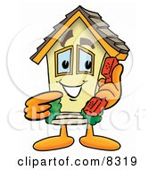 Clipart Picture Of A House Mascot Cartoon Character Holding A Telephone