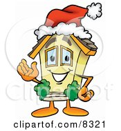 Clipart Picture Of A House Mascot Cartoon Character Wearing A Santa Hat And Waving by Toons4Biz