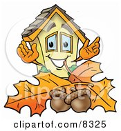 Clipart Picture Of A House Mascot Cartoon Character With Autumn Leaves And Acorns In The Fall
