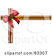 Red Holly Bow In The Corner Of Gold And Maroon Striped Ribbons On White