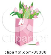 Blank Tag On A Pink Heart Shopping Bag Full Of Pink Tulips