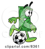 Dollar Bill Mascot Cartoon Character Kicking A Soccer Ball by Toons4Biz