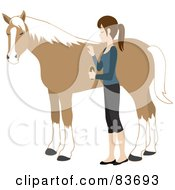 Young Caucasian Woman Grooming Her Pet Horse With A Brush