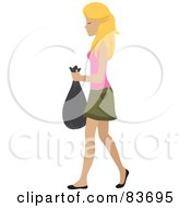 Young Blond Caucasian Woman Taking Out A Bag Of Trash