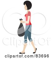 Young Black Haired Caucasian Woman Taking Out A Bag Of Garbage