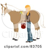 Young Blond Caucasian Woman Washing And Grooming Her Horse