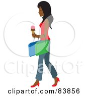 Indian Woman Carrying An Ice Cream Cone And Shopping Bags
