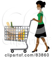 Indian Woman Pushing Bagged Groceries In A Shopping Cart