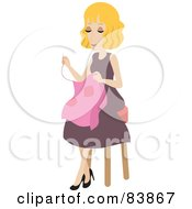 Blond Caucasian Woman Sitting On A Stool And Sewing
