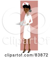 Indian Female Nurse Carrying A Tray Of Meds