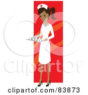 Hispanic Female Nurse Carrying A Tray Of Meds