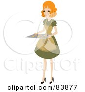 Domestic Strawberry Blond Woman Holding Chocolate Chip Cookies On A Baking Sheet