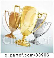 Three 3d Gold Bronze And Silver Trophy Cups With Laurel Designs