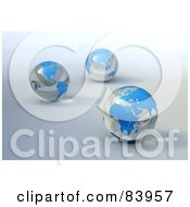 Three 3d Blue And Clear Marble Globes