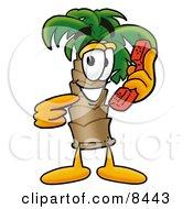Palm Tree Mascot Cartoon Character Holding A Telephone
