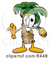 Palm Tree Mascot Cartoon Character Looking Through A Magnifying Glass