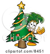 Palm Tree Mascot Cartoon Character Waving And Standing By A Decorated Christmas Tree