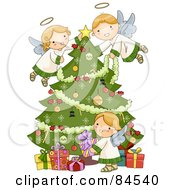 Three Adorable Angels Trimming A Christmas Tree And Arranging Presents