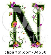 Black Capital Letter N Outlined In Green With Colorful Flowers And Butterflies