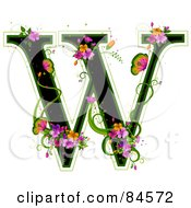 Black Capital Letter W Outlined In Green With Colorful Flowers And Butterflies