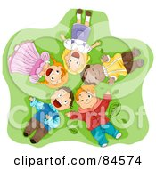 Group Of Happy Diverse Children Laying On Their Backs In Grass Looking Up