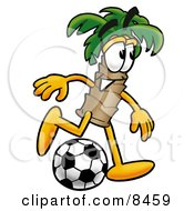 Clipart Picture Of A Palm Tree Mascot Cartoon Character Kicking A Soccer Ball by Toons4Biz
