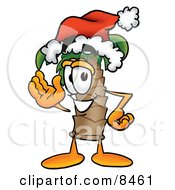 Clipart Picture Of A Palm Tree Mascot Cartoon Character Wearing A Santa Hat And Waving by Toons4Biz
