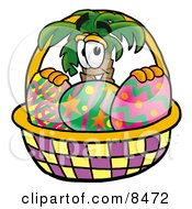 Palm Tree Mascot Cartoon Character In An Easter Basket Full Of Decorated Easter Eggs by Toons4Biz