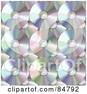 Royalty Free RF Clipart Illustration Of A Background Of Shiny Pastel Colored DVDs Or CDs by Arena Creative