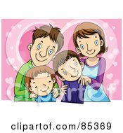 Happy Smiling Family Of Four Posing In Front Of Pink Hearts