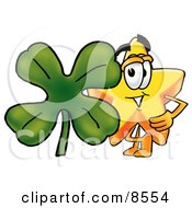 Star Mascot Cartoon Character With A Green Four Leaf Clover On St Paddys Or St Patricks Day