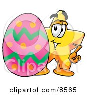 Clipart Picture Of A Star Mascot Cartoon Character Standing Beside An Easter Egg by Toons4Biz