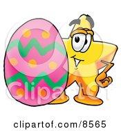 Star Mascot Cartoon Character Standing Beside An Easter Egg