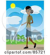 Blind Black Woman Walking Through A Neighborhood With A White Cane